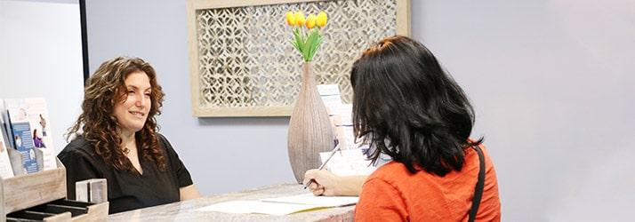 Chiropractor Los Angeles CA Heather Valinsky at Reception Desk