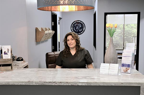 Chiropractor Simi Valley CA Dr. Heather Valinsky At Front Desk