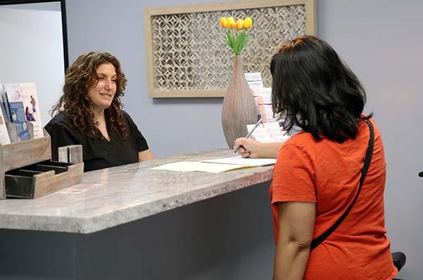 Chiropractor Simi Valley CA Dr. Heather Valinsky Talking with Patient