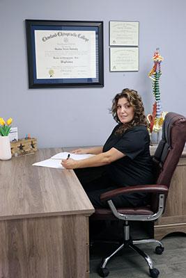 Chiropractor Simi Valley CA Dr. Heather Valinsky Working at Desk