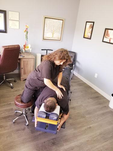 Chiropractor Los Angeles Heather Valinsky Adjusting Patient
